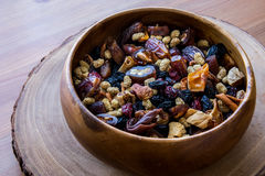 Dried Fruit Walnut, fig, palm, mulberry, date in a wooden bowl Royalty Free Stock Photos