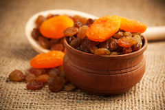Dried fruit on a wooden spoon on a burlap Royalty Free Stock Photos