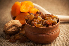 Dried fruit on a wooden spoon on a burlap Stock Images