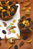 Dried fruits_1. Dried fruits and nuts in bowl and basket on table Royalty Free Stock Photos