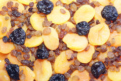 Dried fruits. Background from different dried fruits – apricots, raisins and prunes Royalty Free Stock Images