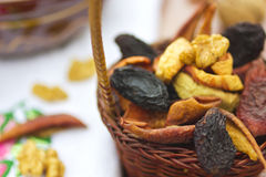 Dried fruits_2. Dried fruits and nuts in bowl and basket on table Stock Images