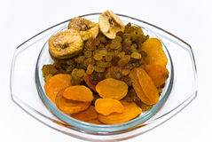Dried fruits. Dried apricots, raisin, fig on a glass dish Royalty Free Stock Photography