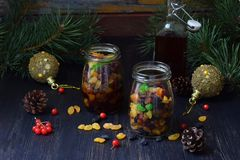 Dried fruits in alcohol, preparation for baking traditional Christmas cake Stollen on dark background. European Xmas traditions. H Stock Photography