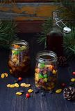 Dried fruits in alcohol, preparation for baking traditional Christmas cake Stollen on dark background. European Xmas traditions. H Royalty Free Stock Photography