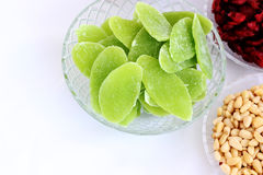 Dried fruits and almonds - symbols of judaic holiday Tu Bishvat. Dried pinapple with apple taste with other dried barries and almonds - symbols of the Jewish royalty free stock image