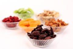 Dried fruits and almonds - symbols of judaic holiday Tu Bishvat. Dried fruits and almonds served in elegant plates - symbols of the Jewish holiday Tu Bishvat royalty free stock image