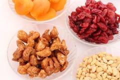 Dried fruits and almonds - symbols of judaic holiday Tu Bishvat. Dried fruits and almonds served in elegant plates - symbols of the Jewish holiday Tu Bishvat stock image
