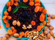 Dried  fruits apricots , cranberries, raisins, prunes and nuts close-up royalty free stock photos