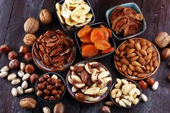 Dried fruits and assorted nuts composition on rustic table.  royalty free stock photos