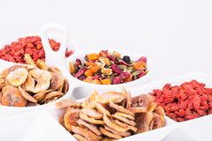 Dried fruits and berries. Dried fruits, berries and seeds in bowls on gray background Stock Image