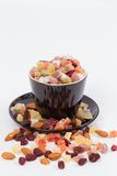 Dried fruits in a black cup Royalty Free Stock Images