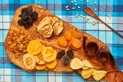 Dried fruits on tablecloth. Dried fruits on blue tablecloth Royalty Free Stock Images