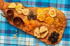 Dried fruits on tablecloth. Dried fruits on blue tablecloth Stock Images