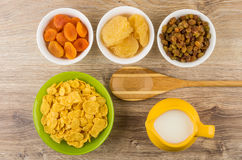 Dried fruits in bowls. Corn flakes and milk Royalty Free Stock Photography