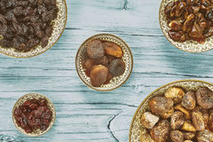 Dried fruits in bowls, retro toning applied Stock Photo