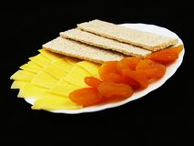 Dried fruits with cheese and diet wholegrain bread Royalty Free Stock Images