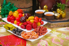 Dried fruits with chinese new year bg Royalty Free Stock Photos