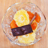 Dried fruits and chocolate in glass bowl Royalty Free Stock Photography