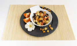 Dried fruits on stone plate with flower Stock Images