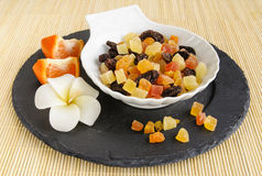 Dried fruits on stone plate with flower Royalty Free Stock Photo
