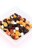 Dried fruits. In a dish on white background, close up Stock Image