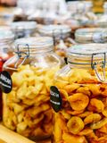 Dried Fruits In Glass Jars For Sale In Market Stock Photography