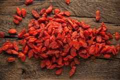 Dried fruits of Goji berries or wolfberry on rustic wooden table Stock Photography