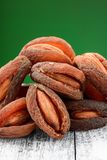 Dried fruits on a green background. Almonds, dried apricots on a green background Stock Image