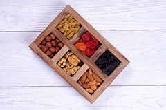 Dried fruits. Hazelnuts, walnuts, raisins and almonds stock images