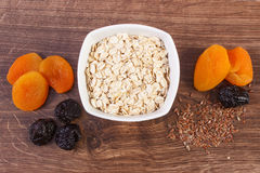 Dried fruits, linseed and oatmeal in bowl, increase metabolism Royalty Free Stock Photography