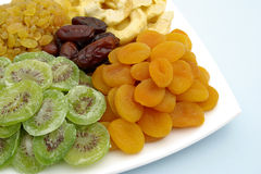 Dried fruits mix. Assorted dried fruits on a plate Stock Photos