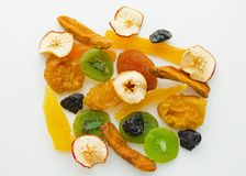 Dried fruits mix. Dried sweet tropical fruits mix isolated over white background stock photos