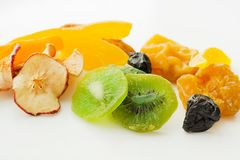 Dried fruits mix. Dried sweet tropical fruits mix isolated over white background stock image