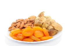 Dried fruits mix. Plate with dried fruit isolated on white background stock photography
