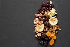 Dried fruits and nut mix on black background, top view. Overhead. Copy space.  royalty free stock photos