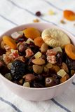 Dried fruits and nut mix in a pink bowl, side view. Close-up.  stock photos