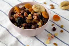 Dried fruits and nut mix in a pink bowl, side view. Closeup.  stock images