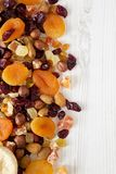 Dried fruits and nut mix on white wooden surface, top view. Copy space. Dried fruits and nut mix on white wooden surface, top view. Overhead, from above, flat royalty free stock photo