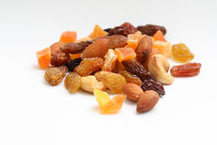 Dried fruits and nuts. Isolated on white royalty free stock photo