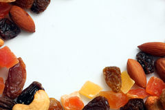 Dried fruits and nuts. Isolated on white royalty free stock photos