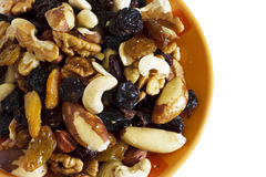 Dried fruits and nuts. On the orange bowl Royalty Free Stock Photos