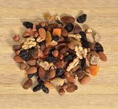 Dried fruits and nuts. On wooden board Royalty Free Stock Photography