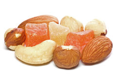 Dried fruits and nuts. Closeup of dried fruits and nuts isolated on white background Stock Photos