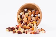 Dried fruits and nuts in a bambus bowl on white background Royalty Free Stock Images