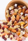 Dried fruits and nuts in a bambus bowl on white background Royalty Free Stock Photography