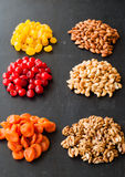 Dried fruits and nuts on black background.  Stock Photography
