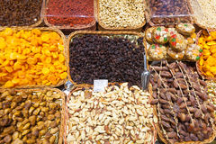 Dried fruits and nuts on  counter Royalty Free Stock Images