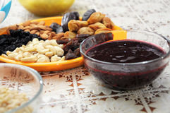 Dried fruits, nuts and currant jam Stock Photography