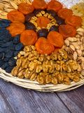 Dried fruits an nuts for healthy heart, full of vitamins and potassium, antioxidant. Organic food for everyone's health. On wooden surface royalty free stock photo